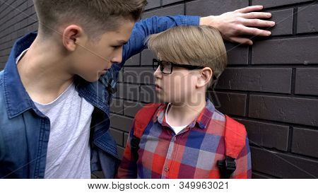 Bully Boy Threatening Classmate Pushing To Wall, Psychological Abuse, Authority
