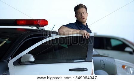 Confident Cop Getting Out From Car, Going To Crime Scene, Patrolling District