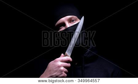 Insane Murderer Touching His Masked Face With Big Knife, Threatening With Murder