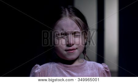 Scared Little Girl Crying And Closing Eyes From Fear, Childhood Phobias, Closeup