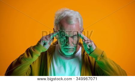 Elderly Male Mentalist Demonstrating Mind-reading Power At Camera, Telepathy
