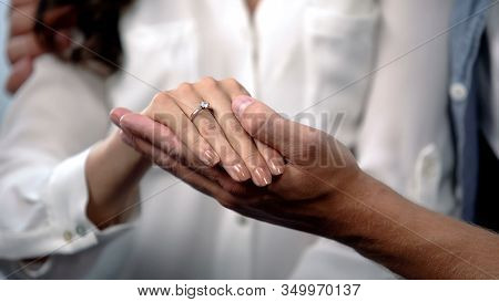 Man Tenderly Holding Fiancee Hand With Engagement Ring, Future Family, Love