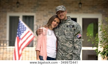 Former Soldier And Girlfriend Hugging, Standing Against Usa Flag, Homecoming