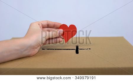 Female Hand Putting Red Heart Sign Church Donation Box, Religious Mercy, Charity