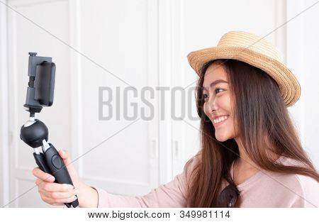 Asian Young Female Blogger Recording Vlog Video With Mobile Phone Live Streaming When Travel.online