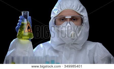 Woman Laboratory Assistant Holding Flask With Flammable Liquid, Toxic Igniter