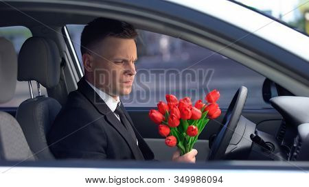 Unhappy Man Looking At Bunch Of Tulips And Deciding To Drive Away, Breakup