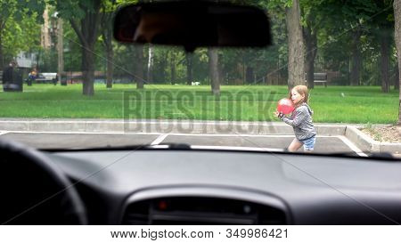 Child Playing With Ball Front Of Driving Car, Risk Of Road Accident, Attention