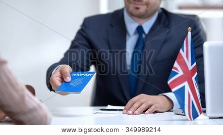 British Embassy Officer Giving Passport To Immigrant, Student Visa Approval