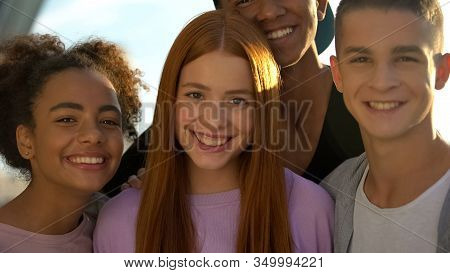Joyful Teenagers Hugging Female Friend Smiling On Camera, Adolescent Wellness