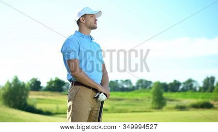 Inexperienced Golf Player With Club In Hands Upset With Failed Shot, Loser