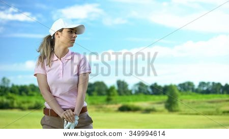 Inexperienced Woman Playing Golf, Unsuccessful Attempt To Hit Ball, Loser