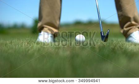 Skilled Golf Player Hitting Ball From Tee, Strike Shot, Recreational Sport Hobby