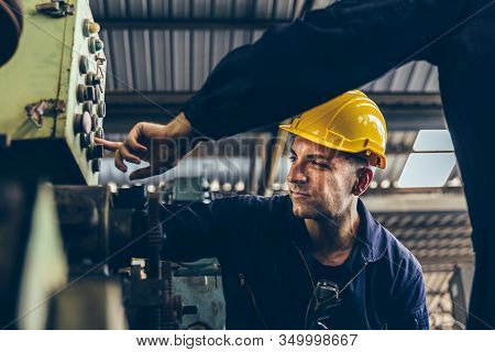 Group Of Industrial Factory Maintenance Engineers Inspect Relay Protection System Of Machinery With