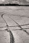 Tire Tracks in the sand at Saint Malo France. poster