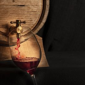 Oak Barrel With A Glass Of Red Wine, Pouring And Tasting At A Winery Cellar, Square Image With A Pla