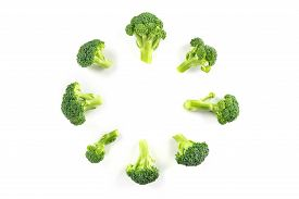 Broccoli Florets, Shot From The Top On A White Background, Forming A Circular Frame With A Place For