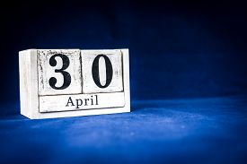 April 30th, Thirtieth Of April, Day 30 Of Month April - Rustic Wooden White Calendar Blocks On Dark