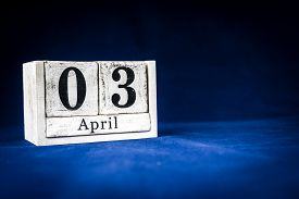 April 3rd, Third Of April, Day 3 Of Month April - Rustic Wooden White Calendar Blocks On Dark Blue B