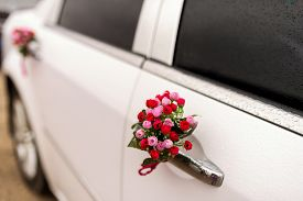 Wedding Car With Beautiful Flower Decorations. White Car, Red Flowers, Wedding Day, Selective Focus,