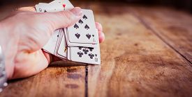 Combination Of Playing Cards | Poker Face | Hand Holding Cards | Games And Gambling