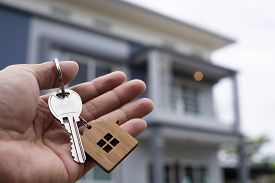 Landlord Unlocks The House Key For New Home.  Real Estate Agents, Sales Agents Concept
