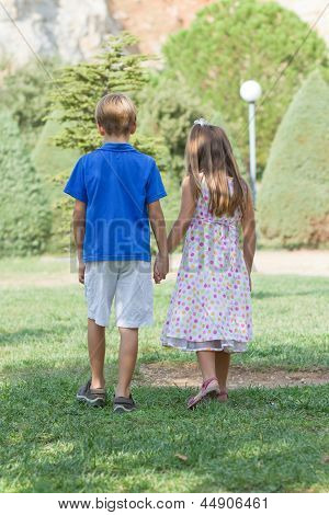 Little Friends Walk Holding Hands
