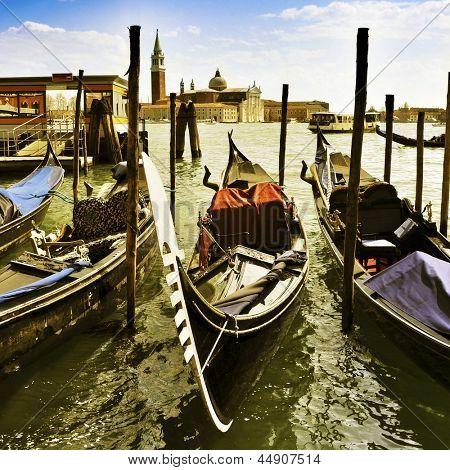gondolas moored in the lagoon in Venice, Italy, and the Church of San Giorgio Maggiore in the background