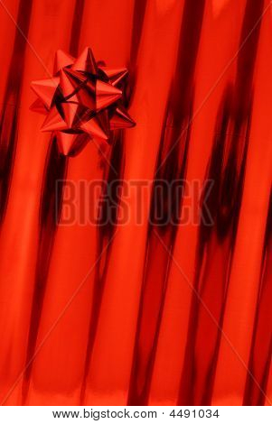 Red Bow And Gift Paper