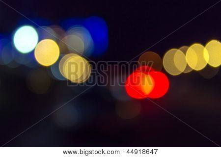 Abstract Blur Of Red And Blue Street Lights At Night