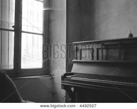 Old Room With A Piano In Black And White