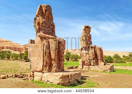 The Colossi of Memnon, two massive stone statues of Pharaoh Amenhotep III in Luxor, Egypt