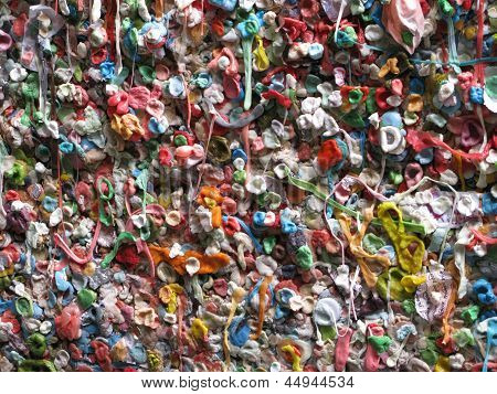 Colorful wall of various gum located at Post Alley in Seattle, Washington. poster