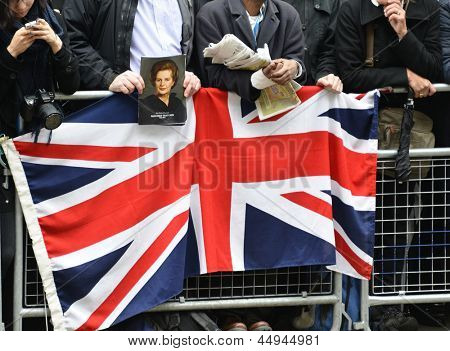 LONDON - UK, APRIL 17: Man holding a portrait of Baroness Thatcher  along the Procession route, on April 17, 2013 in London.