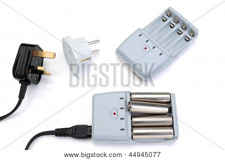 Plug Adapter, Charger And Battery. On A White Background.