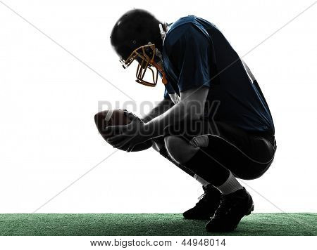 one caucasian defeated american football player man in silhouette studio isolated on white background