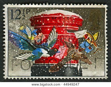 "UK - CIRCA 1983: A stamp printed in UK shows image of The ""Christmas Post"" (pillar-box), circa 1983."