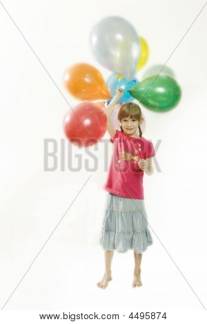 Young Happy Girl With Colour Balloons