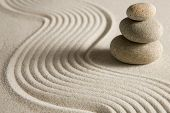 Stack of stones on raked sand; zen concept poster