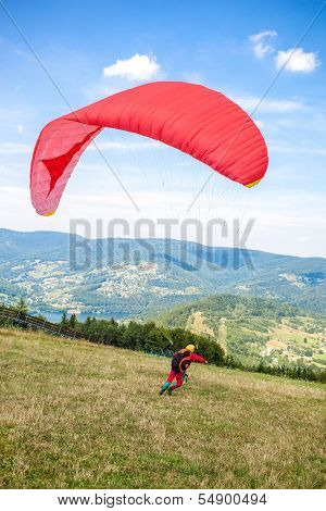 Zar mountain, Poland  - AUGUST 1: Single paraglider starts from slope of Zar mountain in Beskid