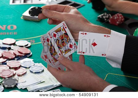 Man Has Ace Up His Sleeve Playing Poker