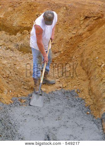 Workman Shoveling Cement