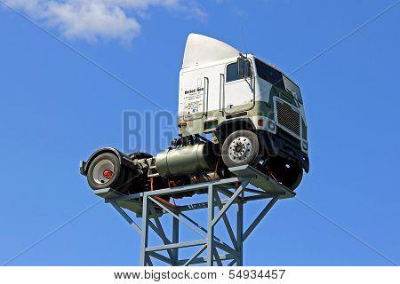 Vintage Freightliner Truck Up Against Blue Sky