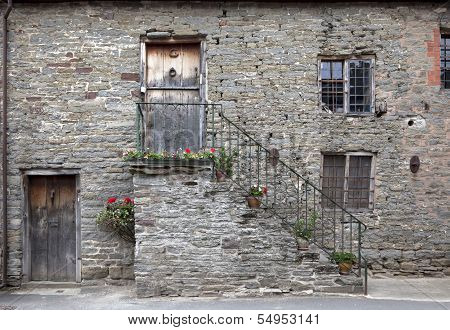 Old stone building facade with outside steps in the village of Clun, Shropshire, England. poster