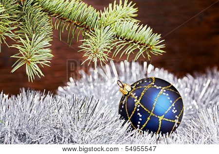 Christmas Decoration. Blue Ball, Tinsel And Fir-tree
