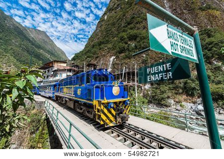 AGUAS CALIENTES, PERU - JULY 17: Perurail train between Aguas Calientes and Ollantaytambo in the Andes at Cuzco Peru on july 17, 2013. PeruRail was founded in 1999 by Lorenzo Sousa and Sea Containers