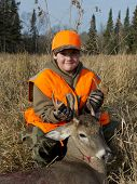 A young deer hunter with his first deer poster