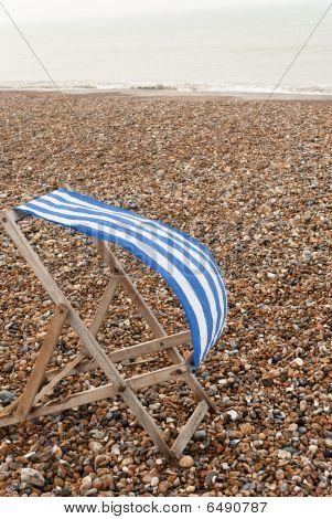 Deckchair On Windy Beach