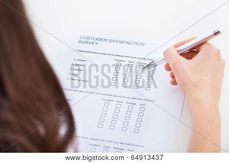 Woman Filling Survey Form