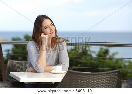 Woman Pensive Sitting In A Terrace Of A Restaurant